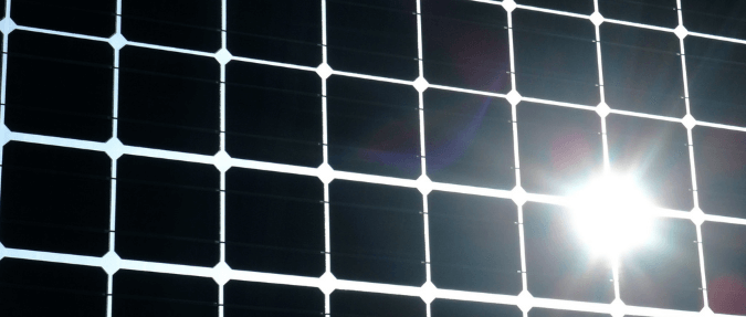 A reflection (glare/ dazzle) off of a photovoltaic solar panel