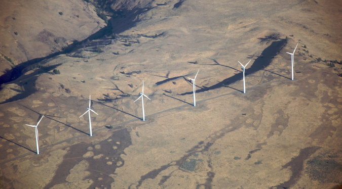 Aerial view of a wind farm in The current position of wind turbine radar mitigation